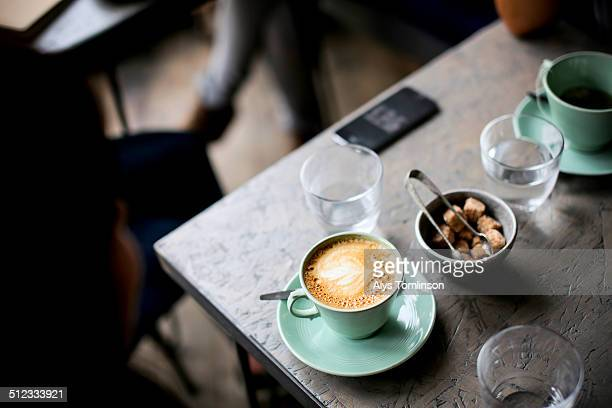 Cup of Coffee on a table in a Cafe