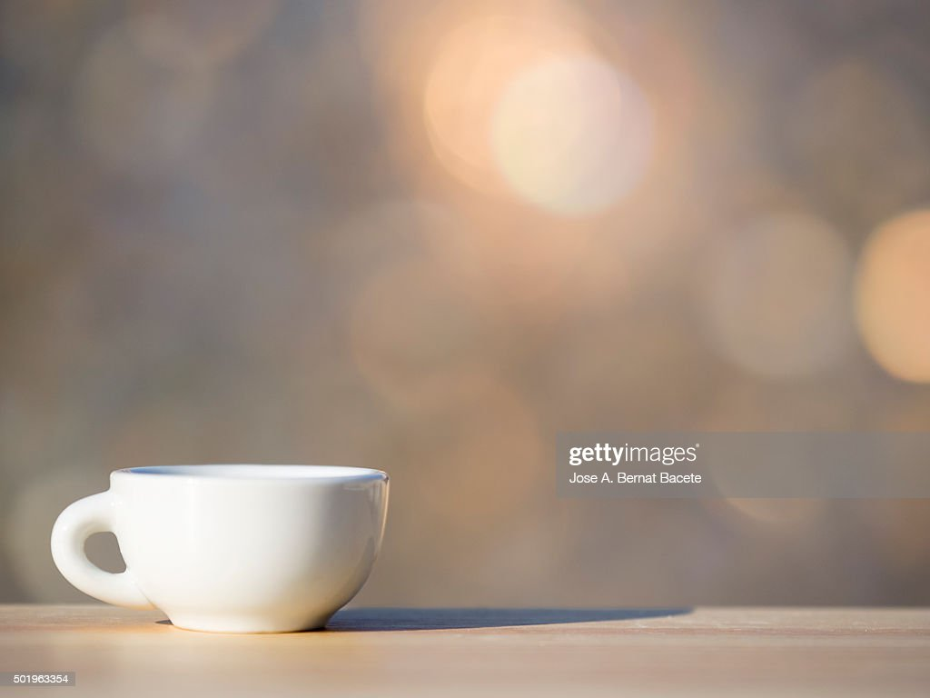 Cup of coffee on a table of wood outdoors : Stock Photo
