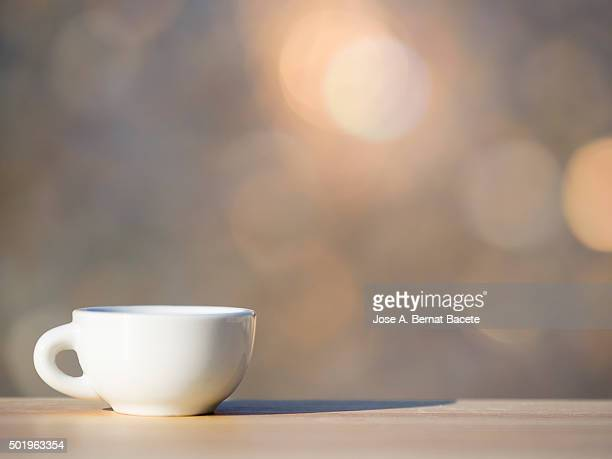 Cup of coffee on a table of wood outdoors