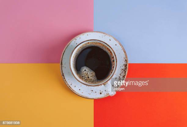 Cup of Coffee on colored background