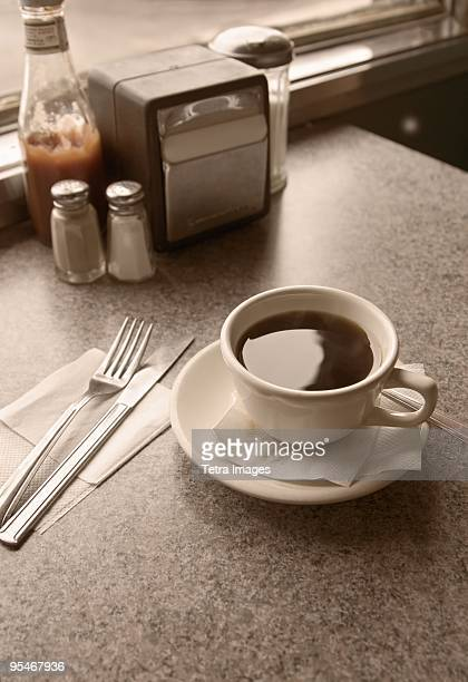 Cup of coffee on diner table