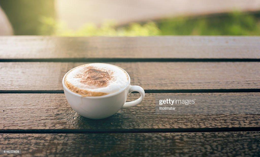 Cup of coffee on wooden table : Bildbanksbilder