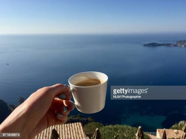 Cup of coffee overlooking Mediterranean Sea