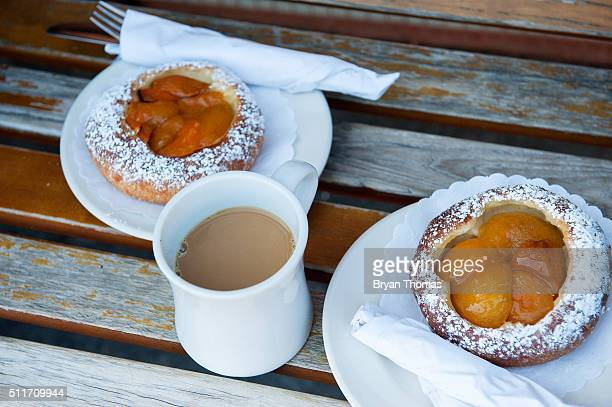 A cup of coffee sits between two pastries outside of Colson Patisserie on February 22 2016 in the Brooklyn borough of New York City A recently...