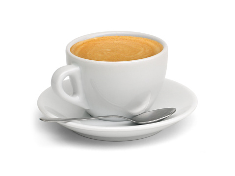 A cup of coffee with a spoon and saucer 186823058