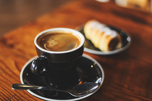 Cup of coffee with bread 1139926640