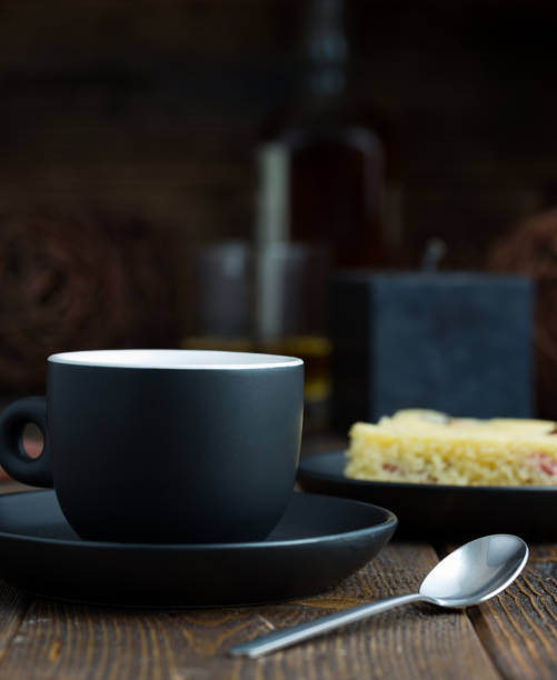 Cup Of Coffee With Cake Behind