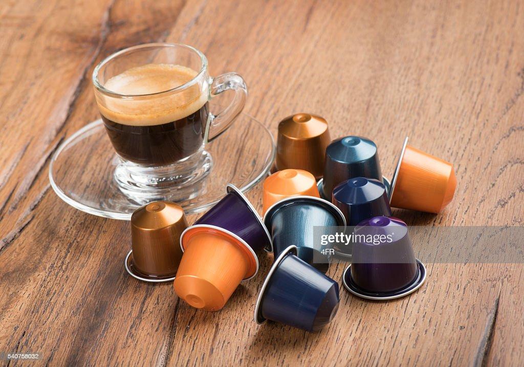 cup of coffee with capsules nestle nespresso kaffeekapseln stock