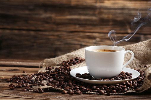 Cup of coffee with coffee beans 521697444