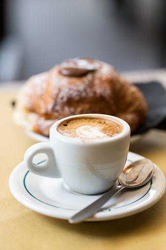 Cup of coffee with croissants on the table 897362454