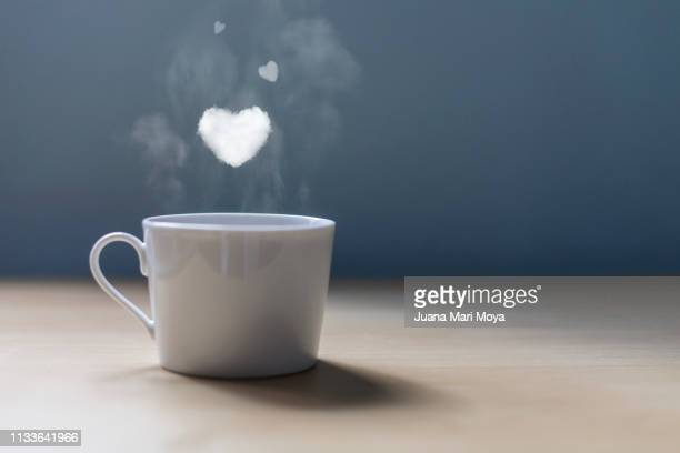 a cup of coffee with lots of love - taza de café stock pictures, royalty-free photos & images