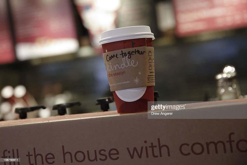 A cup of coffee with the words 'come together' written on the cup sits on the counter at Starbucks, on December 27, 2012 in the Woodley Park neighborhood of Washington, DC. Starbucks CEO Howard Schultz says the words are intended as a message to lawmakers about the damage being caused by the divisive negotiations over the 'fiscal cliff.'