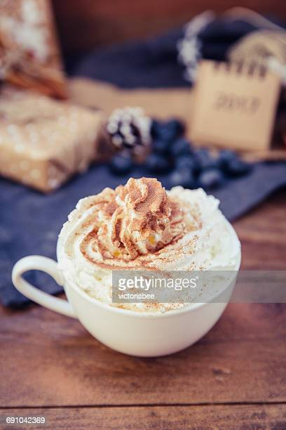 Cup of coffee with whipped cream and chocolate