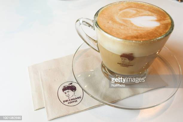 A cup of Doi Chaang coffee inside a coffee shop in Chiang Rai The Doi Chaang brand has been rated in the top 1% of coffees worldwide by the leading...