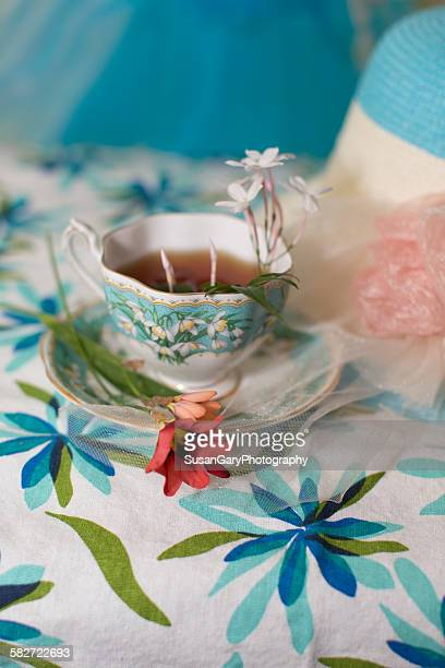 Cup of ea and spring flowers