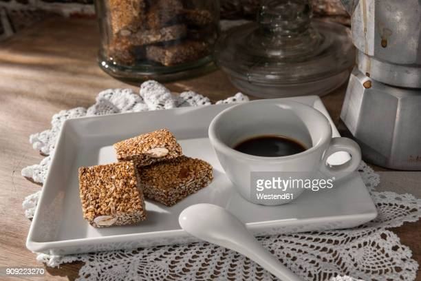 Cup of espresso and sesame almond brittle