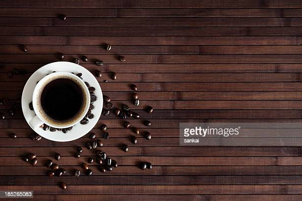 Cup of fresh coffee on dark wood background