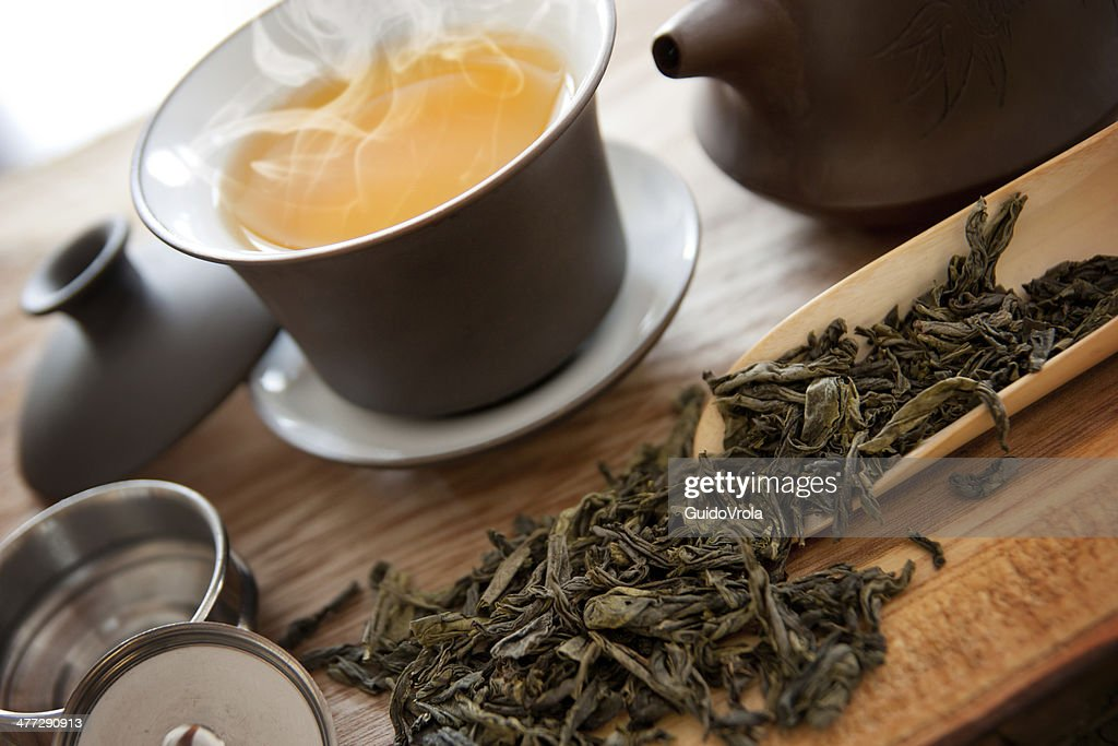 Cup of green tea and accessories : Stock Photo