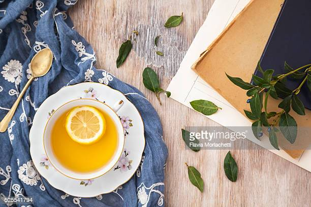 Cup of green tea with lemon slice