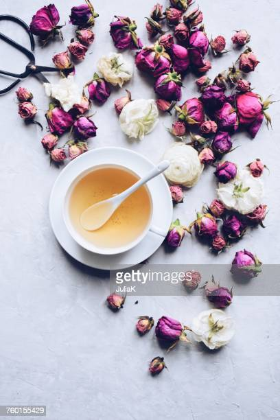 Cup of herbal tea with dried roses