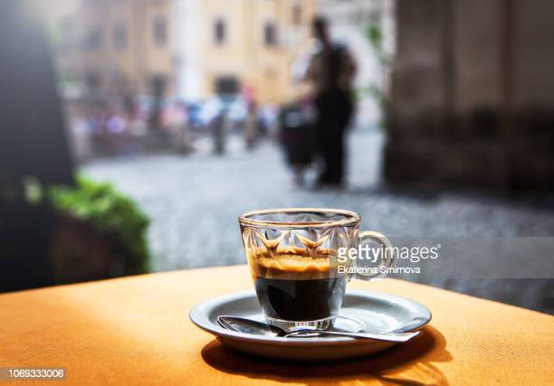 cup of hot black coffee espresso on table in street cafe - espresso stock photos and pictures