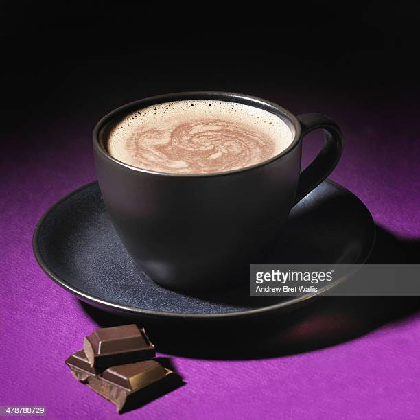 Cup of hot chocolate with milk chocolate pices
