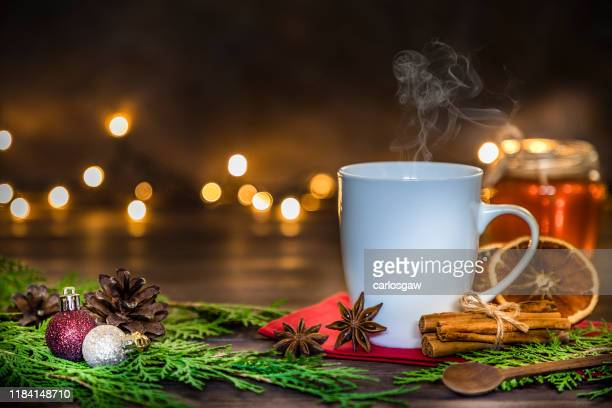 cup of hot christmas drinks with copy space stock photo - tea hot drink stock pictures, royalty-free photos & images