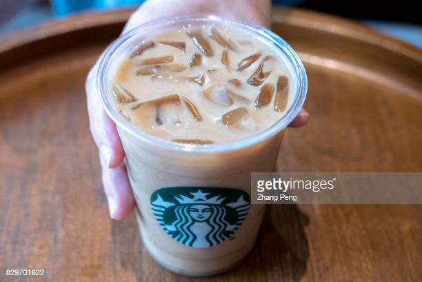 A cup of icy Starbuck coffee Logo on a cup of Starbuck coffee Starbucks 2017 Q2 earnings report shows that the profit from China / Asia Pacific grew...