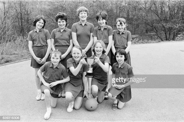 Cup of joy.. St Patrick's show off their trophy after winning the Huddersfield Junior Schools netball competition at Lindley, St Patrick's beat South...