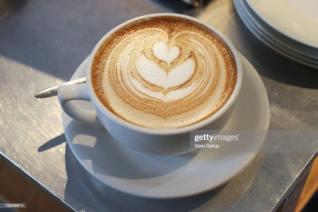A cup of just-brewed flat white, a variation on the classic cappuccino, stands on a counter at Bonanza Coffee Roasters on January 24, 2011 in Berlin, Germany. Bonanza founder Kiduk Reus is among a growing number of so-called third wave artisinal coffee bean roasters who are finding a niche market in Europe and the USA for their carefully-crafted and expensive coffee. Reus insists that the cast iron parts, the slow-roasting abilities and hands-on controls of his flame-roasting, refurbished 1918 Probat machine allow him to develop the most flavour from his carefully selected beans.