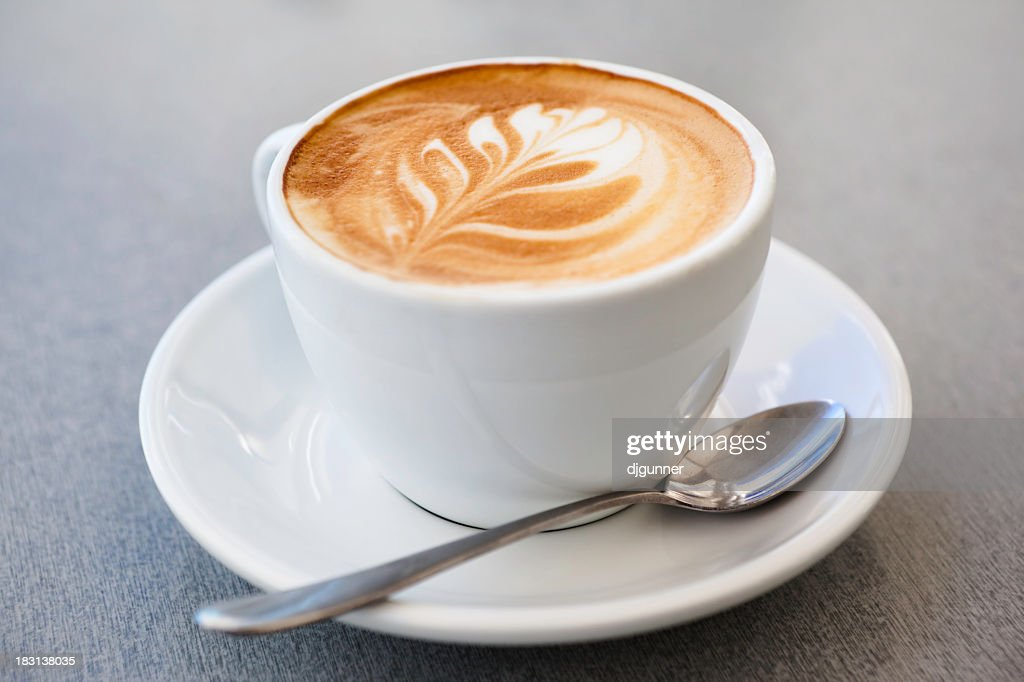 Cup of latte coffee and spoon on gray counter : Stock Photo