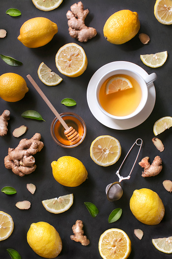 A cup of lemon ginger honey tea on rustic wooden background. - gettyimageskorea