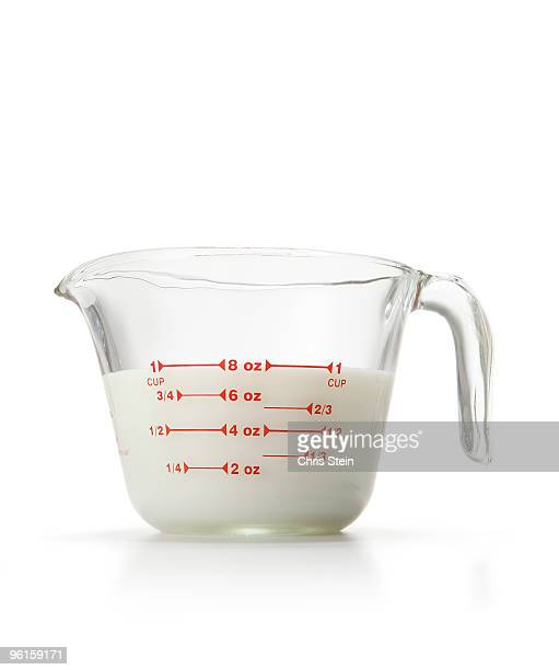 cup of milk - measuring cup stock pictures, royalty-free photos & images