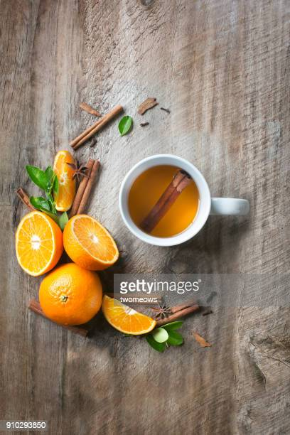 a cup of orange cinnamon tea on rustic wooden background. - immune system stock pictures, royalty-free photos & images