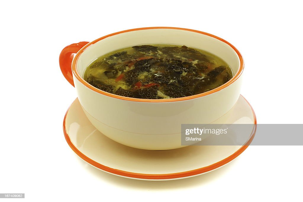 Cup of soup with fresh sorrel : Stock Photo