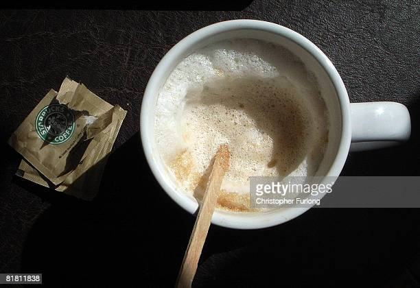 A cup of Starbucks cappuccino sits on a table in one of company's cafes in Northwich on 3 July 2008 in Northwich England Starbucks Corp in the US...