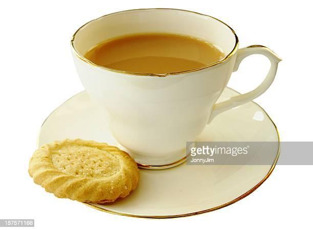 Taza de té y una galleta de manteca
