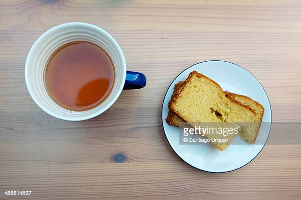 Cup of tea and plate with slices of cake