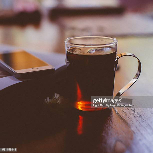 Cup of tea and smartphone