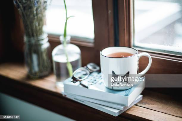 A cup of tea by a window