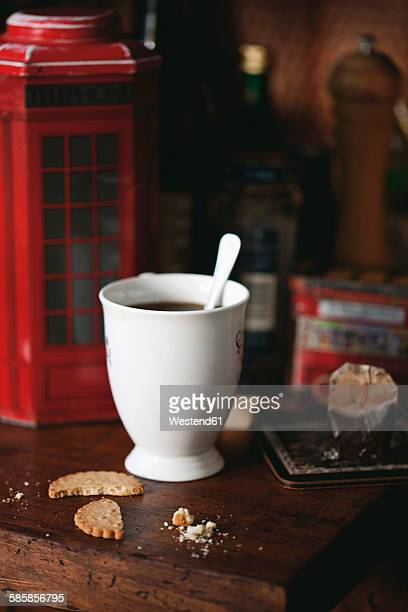 Cup of tea, cookies and cookie box in the shape of London phone box