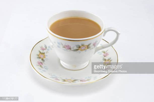 a cup of tea in a china tea cup and saucer - tea cup stock pictures, royalty-free photos & images