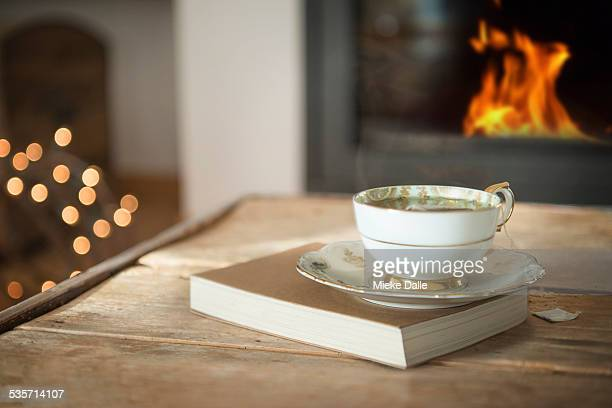 A cup of tea in front of fireplace