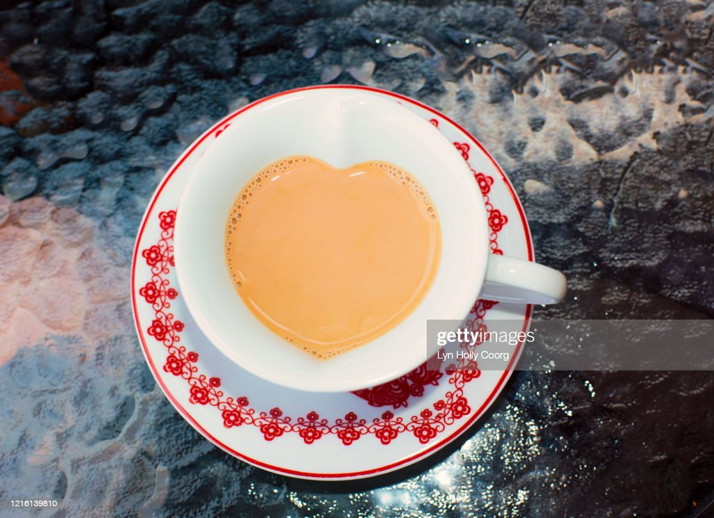 Cup of tea in heart shape cup : Stock Photo