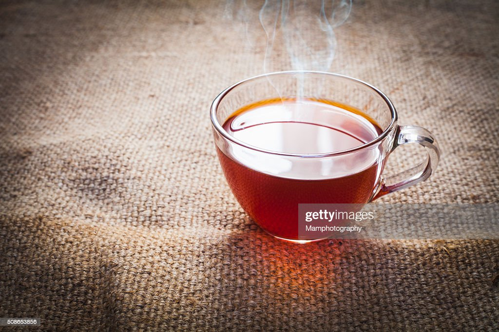 Cup of tea  on brown sack background : Stock Photo