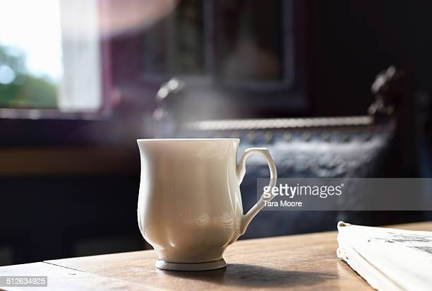 cup of tea on table with steam - tea hot drink stock pictures, royalty-free photos & images