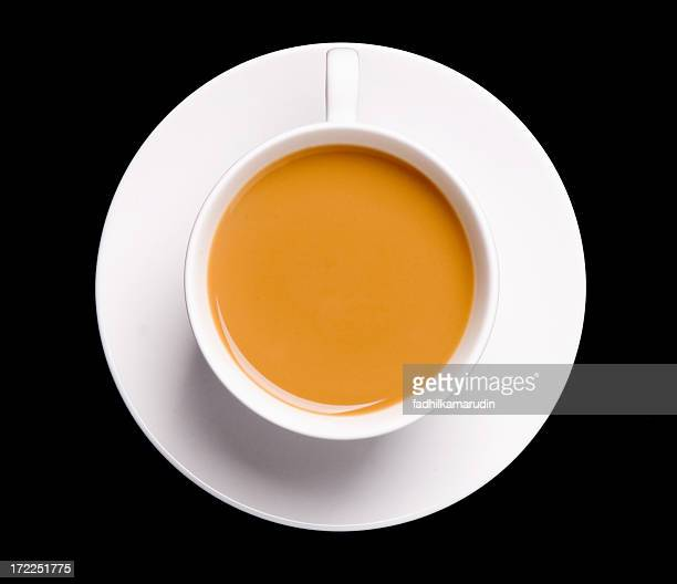 Cup of tea seen from above on a black background