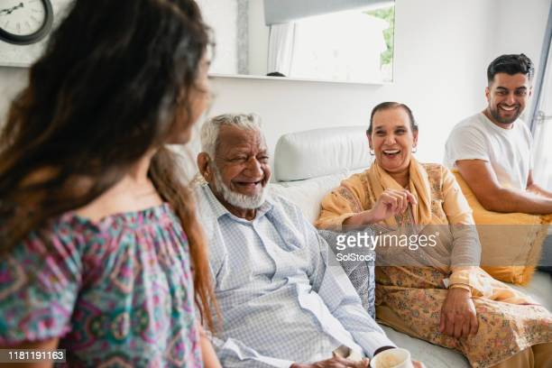 cup of tea with family - indian ethnicity stock pictures, royalty-free photos & images