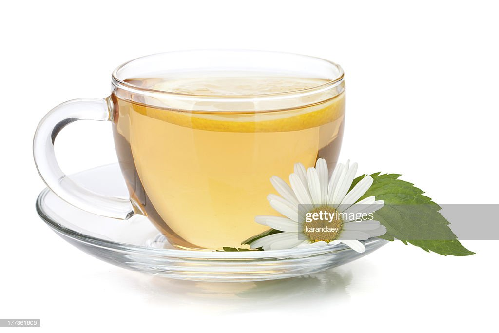 Cup of tea with lemon, mint and chamomile flower