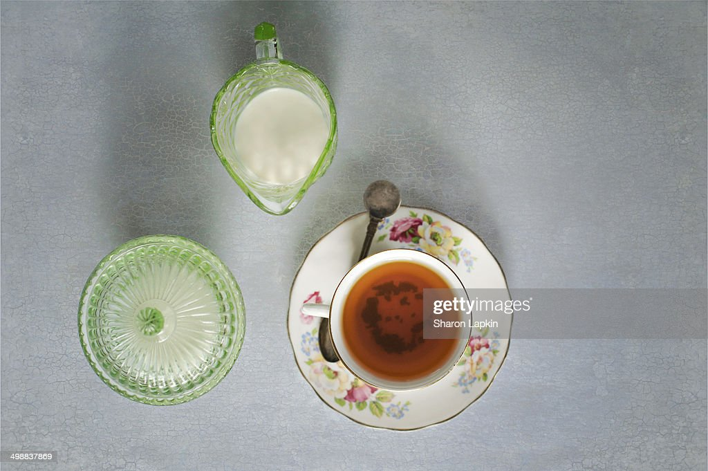 Cup of tea with milk and sugar : Stock Photo